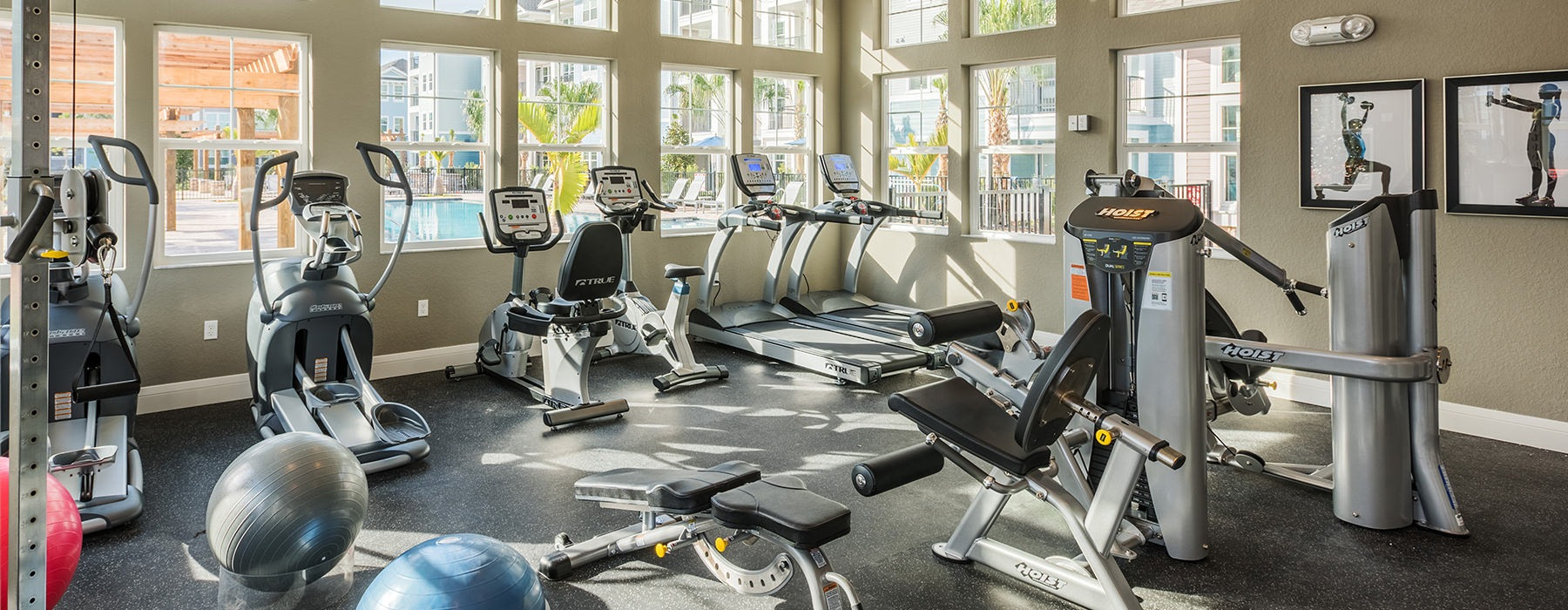 fitness center with large open spaces allowing room for workouts and for using equipment